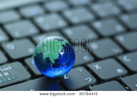 Glass Globe Over Keyboard