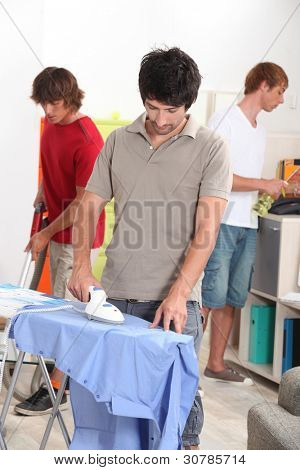 Men housemates doing daily chores