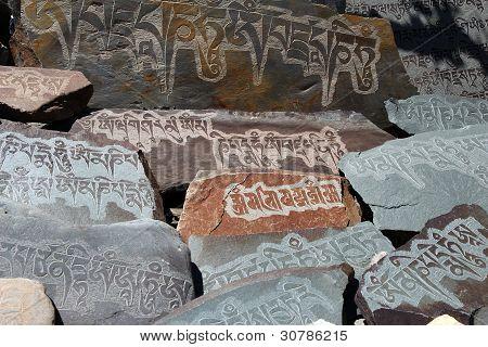 Detail Of Written Mantra On Buddhist Mani Stones