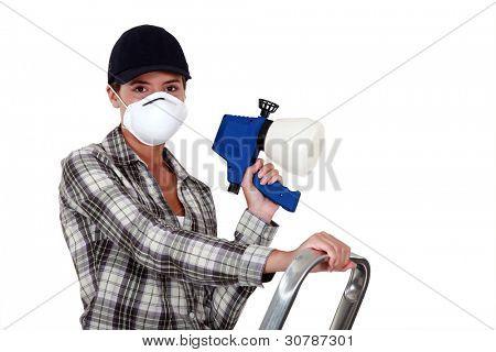 Woman holding a spray gun
