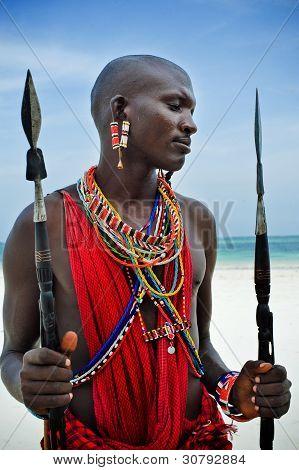 Maasai sitting by the ocean