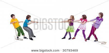 Kids playing tug of war - girls versus boys, isolated