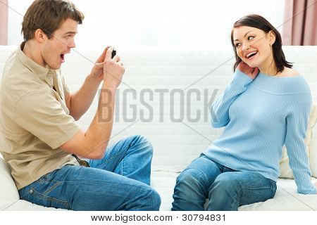 Happy Young Couple Making Fun Photos