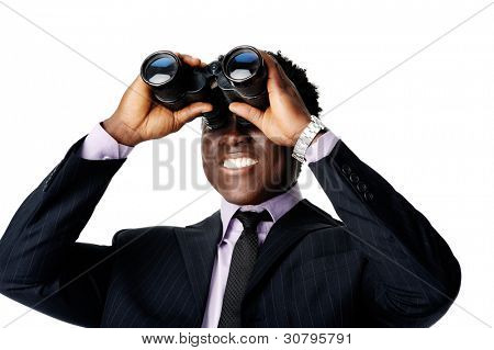 confident young black businessman looking through his binoculars at what the future business vision is