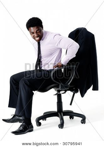 Black businessman in pain from sitting on his office chair with bad posture, long working hours concept. isolated on white