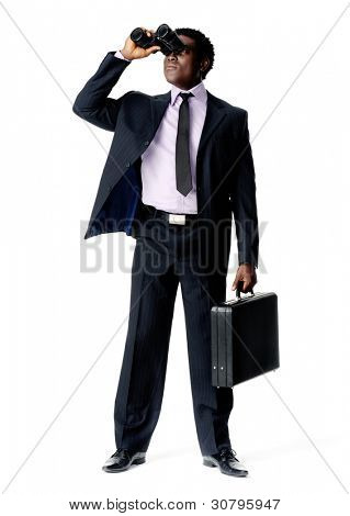 Black African Businessman looking ahead with vision and binoculars while holding a briefcase