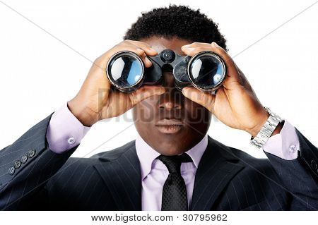 serious binocular businessman looking towards camera. african man