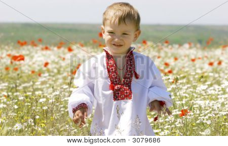 Young Boy In Traditional Clother In Flowers