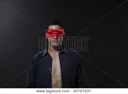 man with blindfolded with red cloth
