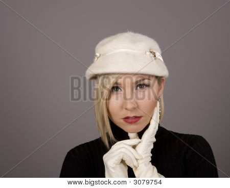 Blonde In Fur Hat With Thumb On Chine