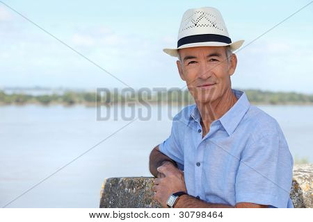 Senior sightseer looking over an estuary from an elevated position