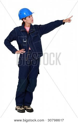 Woman construction worker showing something