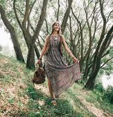 Young Hippie Woman Walking In Spring Forest poster
