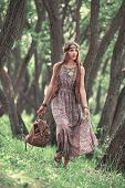 Attractive Young Hippie Woman Walking Among Trees In Forest poster