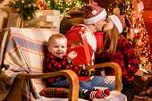 Mom Dad And Cute Son Celebrate Christmas At Home. Family Spread Love And Happiness. Adorable Family  poster