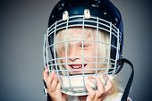 Future Sport Star. Sport Upbringing And Career. Girl Cute Child Wear Hockey Helmet Close Up. Safety  poster
