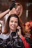 Hair Coloring In The Salon, Hair Styling. Professional Wizard Paints The Hair In The Salon. Beauty C poster