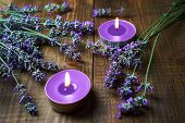 Spa Massage Setting With Lavender Flowers, Scented Aroma Candles On Wooden Background. Close-up. Cop poster