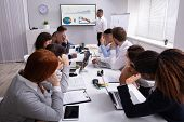 Group Of Business Executives Tired Of Long Meeting In Office poster