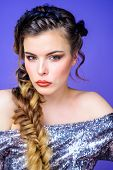 Braided Hairstyle. Beautiful Young Woman With Modern Hairstyle. Girl Makeup Face Braided Long Hair.  poster