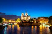 Seine River And Notre Dame De Paris At Night In Paris, France. poster