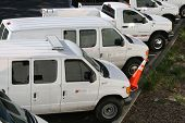 stock photo of fleet  - Service vans ready to go to work - JPG