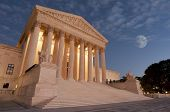 stock photo of supreme court  - A night shot of the front of the US Supreme Court in Washington - JPG