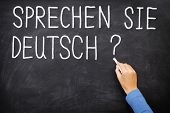 Learning language - German. Sprechen Sie Deutch (Do you speak German) written on blackboard. German