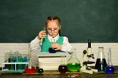 Lab Microscope And Testing Tubes. Little Kids Scientist Earning Chemistry In School Lab. It Was A Li poster