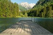 A Scenic View Of The Alps Taken At Jezersko Lake, Slovenia. Scenic Background And Nice Water Reflect poster