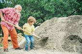 Little Grandchild Helping His Grandfather With Shovel. Childhood Concept. Child And Works. Little Gr poster