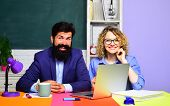 Couple Of Teachers In Classroom. World Teachers Day. Homework. School Job. High School Concept. Stud poster