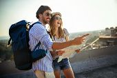 Happy Couple On Vacation Sightseeing City With Map poster