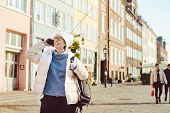 Caucasian Tourist Girl Uses Phone, Hand Calling Smartphone On Copenhagen Nyhavn, Europe Well Known T poster