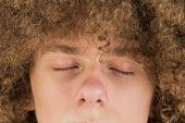 Cropped Portrait Of A Young Curly European Man With Long Curly Hair And Closed Eyes Close Up. Very L poster