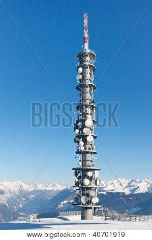 Radio Tower On A Snowy Mountain Summit