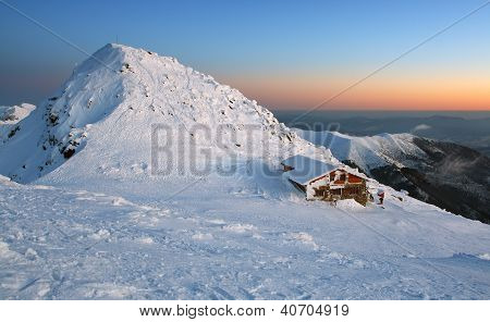 Sunset In Mountains Low Tatras - Slovakia Name Of Peak Is Chopok Ski Resort Jasna With Alpine Chalet