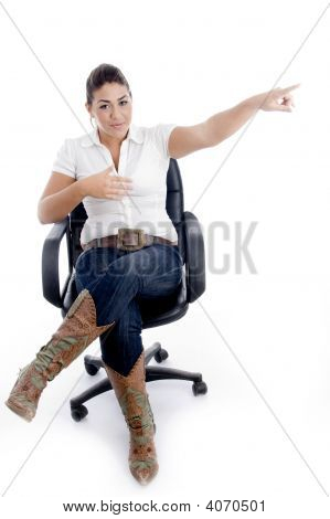 Pointing Female Sitting On Chair