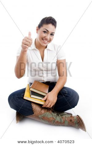 Pointing Female Holding Books