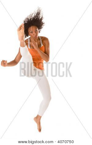Sporty Ethnic Fitness Woman Jumping And Kicking (Motion Blur)