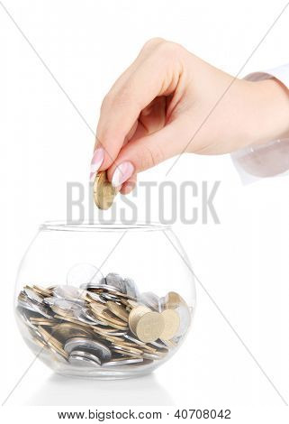 Woman hand with coins in glass jar isolated on white