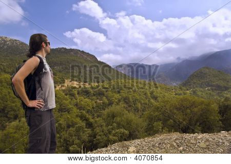 Hiker With Small Backpack In Mountains