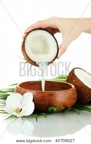 Coconut with coconut milk and leaves, isolated on white