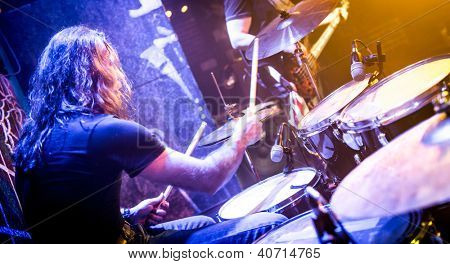 musician playing drums on stage