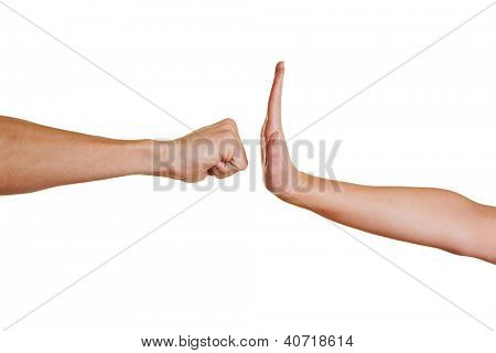 Hand with open palm stopping angry clenched fist