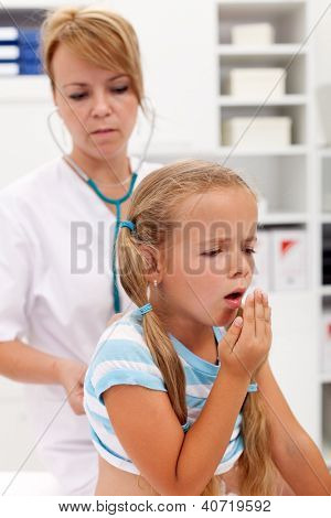 Coughing little girl on health checkup at the doctor