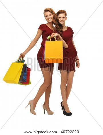 picture of two teenage girls in red dresses with shopping bags