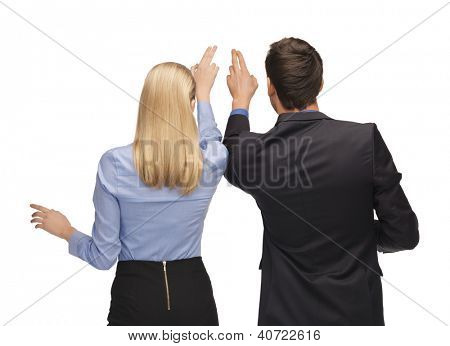 picture of man and woman working with something imaginary.