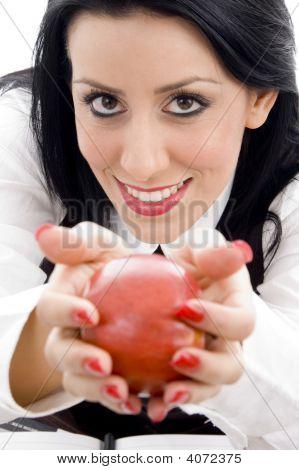 Female Holding An Apple
