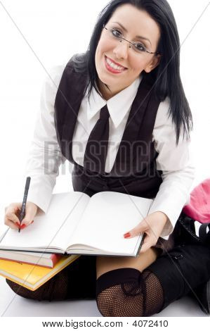Female Student Making Her Notes